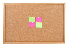 Blank sticky notes pinned on cork memo board Stock Image