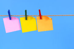 Blank post it sticky notes in a row on a rope or string with copy space Royalty Free Stock Images