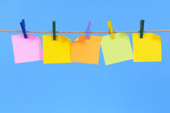 Row of blank post it sticky notes on a rope, copy space Stock Photo