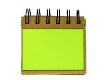 Blank sticky notes stuck to spiral notebook Stock Image