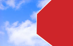 Blank Stop. A stop sign hangs from a poll with a blue cloudy sky as a backdrop Royalty Free Stock Images