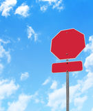 Blank Stop Sign. A blank stop sign is in front of a blue, cloudy sky. Use the area to type in your message Royalty Free Stock Photos