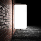 Blank street advertising billboard. On brick wall at night Stock Images