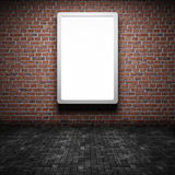 Blank street advertising billboard. On brick wall at night Stock Image