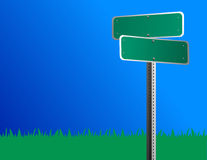 Blank Street Sign. A blank green road/street sign is against a bright blue sky and grass is behind it Stock Photo
