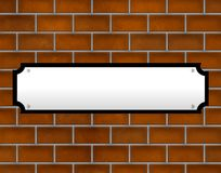 Blank street sign on brick wall. Blank street sign hanging on brick wall Stock Images