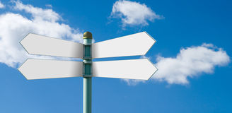 Blank street sign post with 4 white signs royalty free stock photography