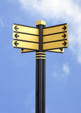 Blank street sign post with 6 signs. Yellow direction sign with path on blue sky Stock Photo