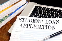 Blank student loan application on desktop. With books and laptop