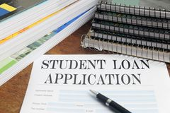 Blank student loan application on desktop Royalty Free Stock Photos