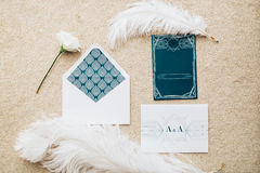 Blank stylized romantic invitation on carpet background. Top view Stock Photo
