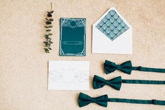 Blank stylized romantic invitation on carpet background. Top view Royalty Free Stock Image