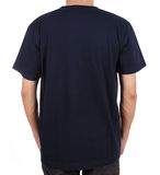 Blank t-shirt on man (back side). Blank black t-shirt on man (back side) isolated on white background Royalty Free Stock Images