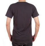 Blank t-shirt on man (back side). Blank black t-shirt on man (back side) isolated on white background Royalty Free Stock Photos