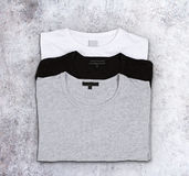 Blank t-shirts on a concrete surface Royalty Free Stock Photography