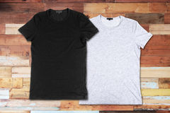 Blank t-shirts on a wooden surface royalty free stock image