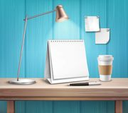 Blank Table Calendar On Wooden Desk. Blank table calendar lamp pen and cup on wooden desk on blue wall background 3d vector illustration Royalty Free Stock Photography