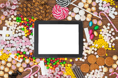 Blank tablet computer and candy Stock Image