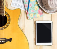 Blank Tablet with Guitar instrument for Music Contents Stock Photo