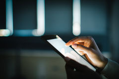 Blank tablet holding in female hands. Blurred Royalty Free Stock Photography