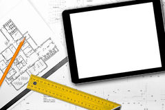 Blank tablet on house project blueprints Stock Image