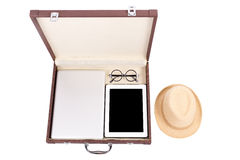 Blank tablet, laptop glasses and hat in briefcase Royalty Free Stock Photo