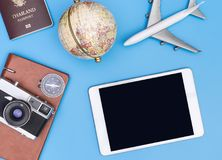 Blank tablet mock up with retro  travel objects. Blank tablet screen mock up with retro  travel objects Royalty Free Stock Photo