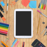Blank Tablet phone  book and school tools on wood background Stock Images
