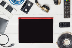 Blank Tablet screen and Entertainment technology objects Royalty Free Stock Image