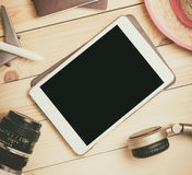 Blank tablet screen template mock up for summer travel equipments. Stock Photo