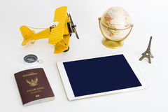 Blank tablet screen with travel objects on white background Royalty Free Stock Photography