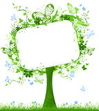 Blank tablet on spring tree. Royalty Free Stock Photo