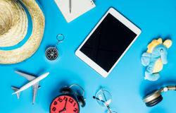 Blank tablet with travel toys and objects. Blank tablet screen with travel toys and objects Royalty Free Stock Photos