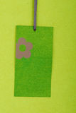 Blank tag. Tag with flower on green recycled paper Stock Photography