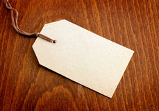 Blank tag. On wooden background Royalty Free Stock Photo
