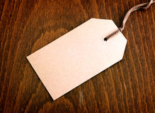 Blank tag. On wooden background Stock Image