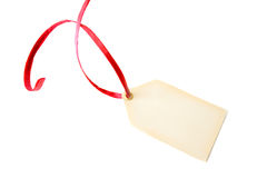 Blank Tag. A blank tag with a red ribbon isolated on a white background Royalty Free Stock Photos