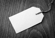 Blank tag. On wooden background Royalty Free Stock Images