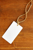Blank tag. Over wooden background, place your own text here Stock Image