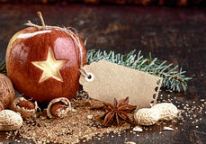 Blank Tag on Christmas Apple on Wooden Table Stock Photo