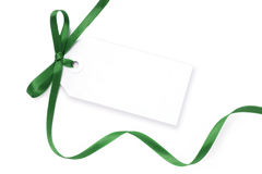Blank Tag with Green Ribbon. Blank gift tag tied with a bow of green satin ribbon.  Isolated on white, with soft shadow Stock Images