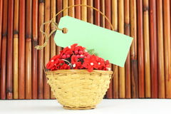 Blank tag or label with space for text on bamboo flower basket. For love valentine romantic thankyou related message work royalty free stock photo
