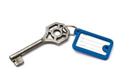 Blank tag and old key Stock Photo