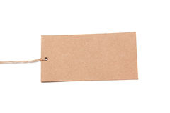 Blank tag tied with brown string. Stock Photos