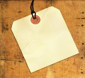 Blank Tag on Weathered Wood Stock Images