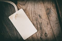 Blank tag on wooden background royalty free stock photography