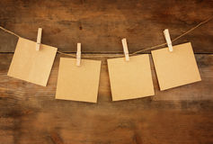 Blank tags hanging on wooden background Royalty Free Stock Image