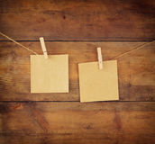 Blank tags hanging on wooden background Royalty Free Stock Photo