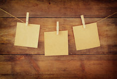 Blank tags hanging on wooden background Stock Photography