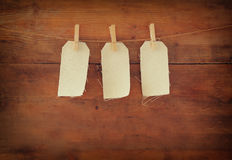Blank tags hanging on wooden background Stock Image